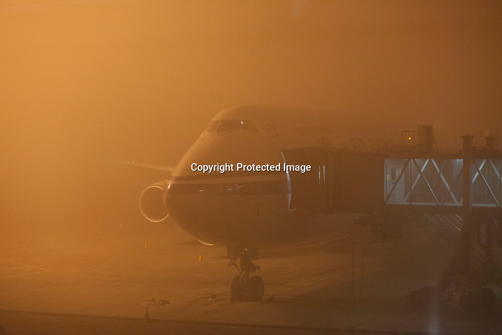 "BEIJING, DEC.23,2015 : a view of a plane that's ""stranded"" at Beijing airport due to ""harzadous"" smog during Beijing's 2.nd ""red alert"" in one month."