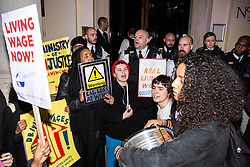 London, UK. 12th February, 2019. Members and supporters of grassroots trade union United Voices of the World protest outside the Gadson Club in Pall Mall on the occasion of a reception with Justice Secretary David Gauke against his refusal to negotiate with the trade union over their demands for the London Living Wage, annual leave and sick pay for outsourced cleaners, security guards and receptionists working at the Ministry of Justice, all of whom have been on strike for varying periods recently. The Gadson Club is the official alumni club for the Oxford University Conservative Association.