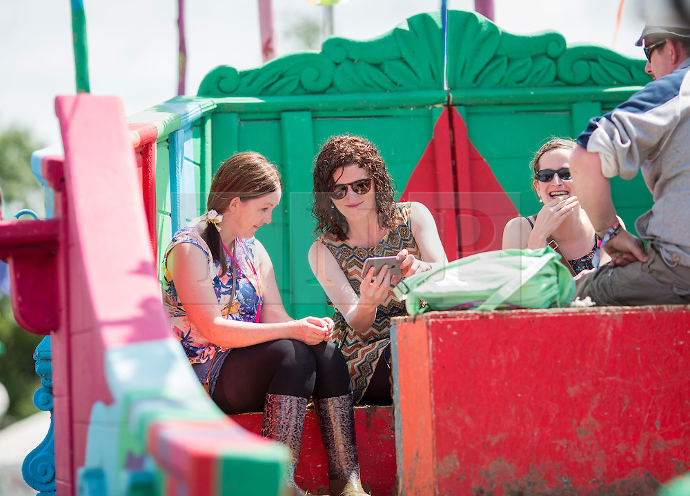 © Licensed to London News Pictures. 24/06/16. Revellers enjoy the sunny weather today at the Glastonbury Festival in Pilton, Somerset. Photo credit should read Brad Wakefield/LNP
