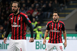 December 9, 2018 - Milan, Milan, Italy - Gonzalo Higuain #9 of AC Milan and Hakan Calhanoglu #10 of AC Milan during the serie A match between AC Milan and Torino FC at Stadio Giuseppe Meazza on December 09, 2018 in Milan, Italy. (Credit Image: © Giuseppe Cottini/NurPhoto via ZUMA Press)