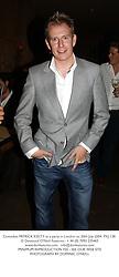 Comedian PATRICK KIELTY at a party in London on 20th July 2004.PXJ 138