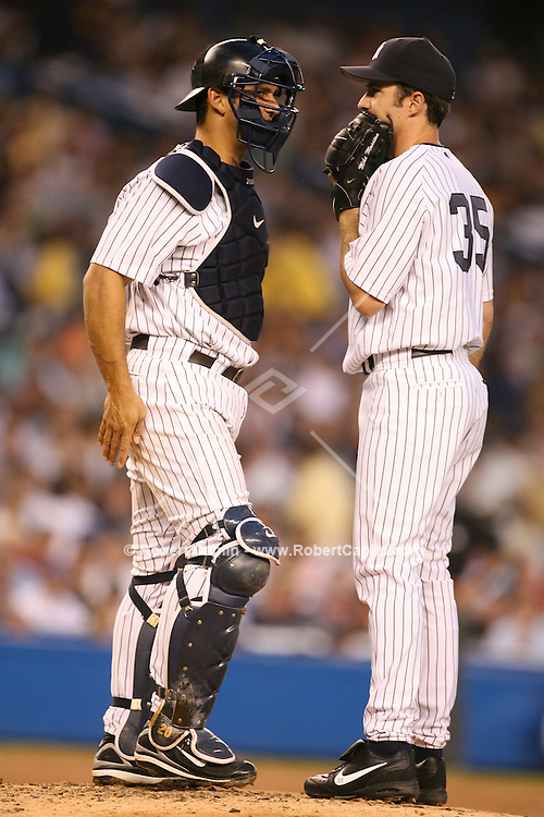 Opening pitcher Mike Mussina, right, talks to catcher Jorge Posada during the Subway Series between the New York Mets and the New York Yankees at Yankees Stadium, Friday, June 30, 2006... (Robert Caplin For the New York Times)..