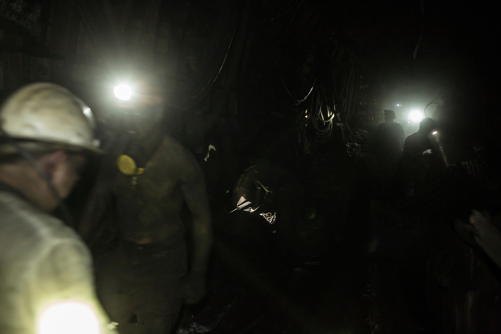 Miners walk through a tunnel 1300 meters underground at the Shcheglovskaya Coal Mine on Friday, March 25, 2016 in Makiivka, Ukraine.