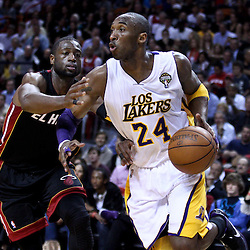 March 10, 2011; Miami, FL, USA; Los Angeles Lakers shooting guard Kobe Bryant (24) drives past Miami Heat shooting guard Dwyane Wade (3) during the first quarter at the American Airlines Arena.  Mandatory Credit: Derick E. Hingle