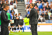 Phillip Cocu of Derby County (Manager) reacts to Tom Lawrence of Derby County (10) scoring his first goal for 0-1 during the EFL Sky Bet Championship match between Huddersfield Town and Derby County at the John Smiths Stadium, Huddersfield, England on 5 August 2019.
