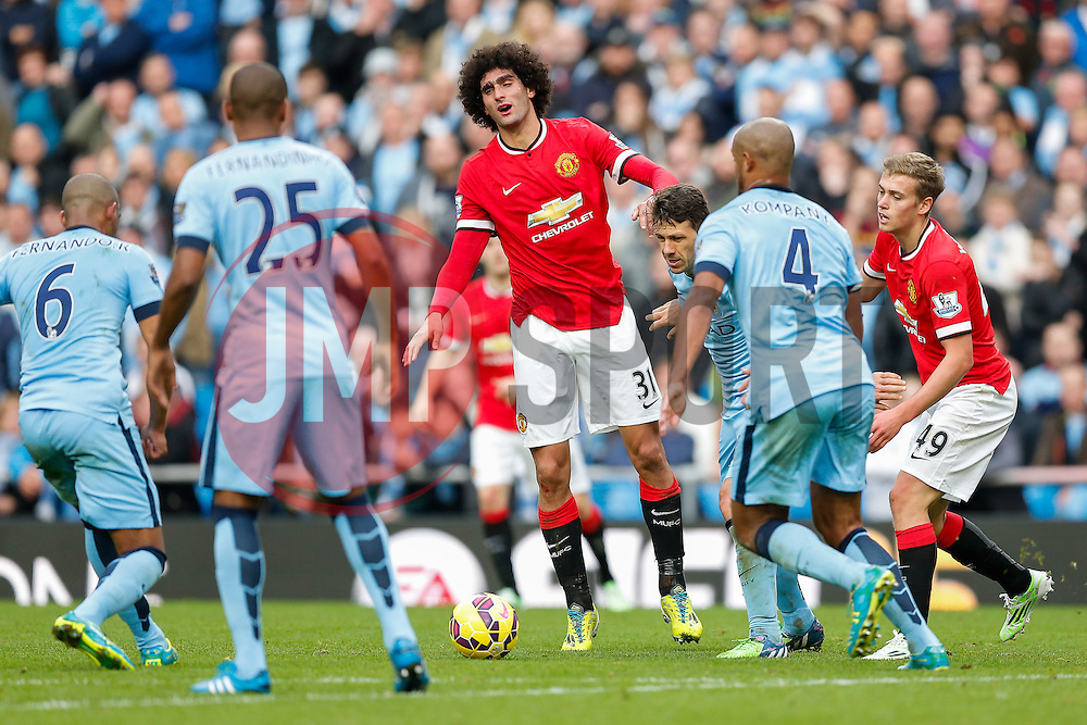 Marouane Fellaini of Manchester United is challenged by Martin Demichelis of Manchester City - Photo mandatory by-line: Rogan Thomson/JMP - 07966 386802 - 02/11/2014 - SPORT - FOOTBALL - Manchester, England - Etihad Stadium - Manchester City v Manchester United - Barclays Premier League.