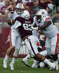 Texas A&M defensive lineman Jayden Peevy (93) sacks Auburn quarterback Jarrett Stidham (8) during the first quarter of an NCAA college football game on Saturday, Nov. 4, 2017, in College Station, Texas. (AP Photo/Sam Craft)