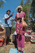 Zombie chic: Indonesian province's bizarre annual ritual of digging up its dead to give them a wash, groom and dress them in new clothes<br /> <br /> They say the dead live on in our hearts and minds - but in one Indonesian province, the deceased continue to walk the earth in a rather more literal, zombie-like fashion. <br /> Families in Toraja in South Sulawesi dig up the bodies of their dead relatives before washing, grooming and dressing them in fancy new clothes. <br /> Even dead children are exhumed - two of these photos show the skeleton of a baby wrapped in a print dress with a doll laid next to it. <br /> Damaged coffins are fixed or replaced, and the mummies are then walked around the province by following a path of straight lines. <br /> The ritual is called Ma'nene, or The Ceremony of Cleaning Corpses.<br />  According to the ancient Torajan belief system, the spirit of a dead person must return to his village of origin. <br /> So if a person died on a journey, the family would go to the place of death and accompany the deceased back home by walking them back to the village.<br /> In the past, people were frightened to journey far, in case they died while they were away and were unable to return to their village.<br /> <br /> Photo shows: In need of a comb: A man brushes the hair of a female corpse<br /> ©Exclusivepix Media