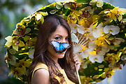 UNITED KINGDOM, Woking: 12 January 2018 Model Jessie Baker gets up close and personal with a Blue Morpho butterfly at the new and spectacular 'Butterflies in the Glasshouse' exhibit at the RHS Garden Wisley this morning. The exhibit runs from 13 January - 4th of march 2018. Rick Findler / Story Picture Agency