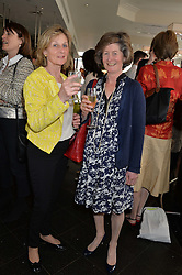 Left to right, MARCIA GIBBS and CAROLYN ENNIS at a ladies lunch in aid of the charity Maggie's held at Le Cafe Anglais, 8 Porchester Gardens, London on 29th April 2014.