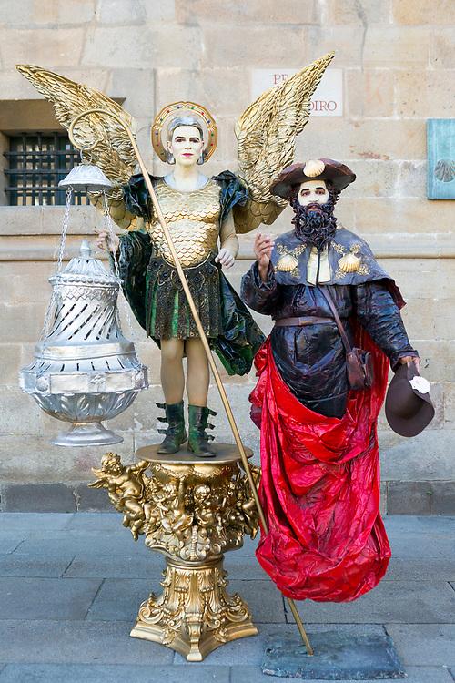 SANTIAGO DE COMPOSTELA, SPAIN - 10th October 2017 - Portrait of living statue performers at the Praza do Obradoiro square, Santiago de Compostela, Galicia, Spain.
