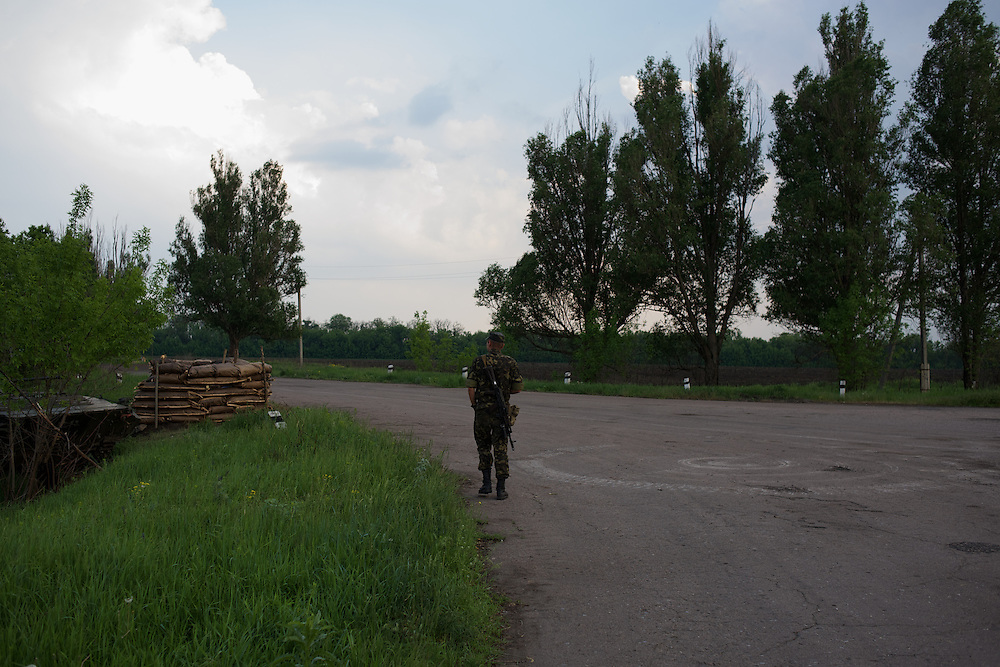 Ukrainian soldiers guard a checkpoint in Novatroizk, eastern Ukraine. Pro-Russian militants ambushed Ukrainian troops nearby the day before, killing seven and wounding another eight in the most deadly attack yet on Ukrainian forces.