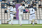 James Vince of Hampshire and Jimmy Adams of Hampshire running between the wickets with bowler Steven Patterson of Yorkshire wtching on during the Specsavers County Champ Div 1 match between Hampshire County Cricket Club and Yorkshire County Cricket Club at the Ageas Bowl, Southampton, United Kingdom on 21 April 2017. Photo by Graham Hunt.