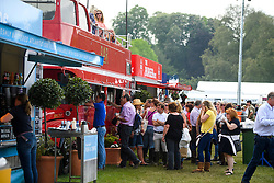 © London News Pictures. 12/05/2016. Windsor, UK. People queue for drinks on the first day of the 2016 Royal Windsor Horse Show, held in the grounds of Windsor Castle in Berkshire, England. The opening day of the event was cancelled due to heavy rain and waterlogged grounds. This years event is part of HRH Queen Elizabeth II's 90th birthday celebrations.  Photo credit: Ben Cawthra/LNP