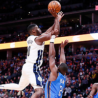 09 November 2017: Denver Nuggets guard Emmanuel Mudiay (0) goes for the layup against Oklahoma City Thunder guard Raymond Felton (2) during the Denver Nuggets 102-94 victory over the Oklahoma City Thunder, at the Pepsi Center, Denver, Colorado, USA.