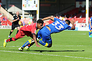Walsall FC defender Rico Henry (3) fouls AFC Wimbledon striker Lyle Taylor (33) penalty is awarded during the EFL Sky Bet League 1 match between Walsall and AFC Wimbledon at the Banks's Stadium, Walsall, England on 6 August 2016. Photo by Stuart Butcher.