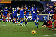 AFC Wimbledon defender Paul Robinson (6) celebrating after scoring during the EFL Sky Bet League 1 match between AFC Wimbledon and Coventry City at the Cherry Red Records Stadium, Kingston, England on 14 February 2017. Photo by Matthew Redman.