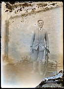 eroding glass plate photo of smiling young adult man