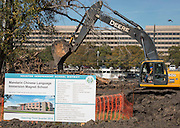 Satterfield & Pontikes Construction workers prepare the site of the new Mandarin Chinese Language Immersion Magnet School for construction of the building, January 5, 2015.