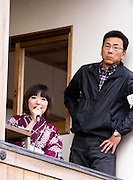 Announcer (usually Miss Kuwana City) and supervisor just before the start of the annual Shinto Tado Horse Festival.