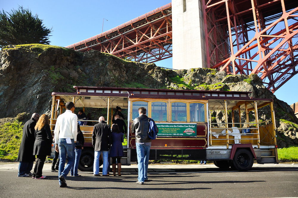 Uzoezi & Noam's guests load back onto the cable car in the shadow of the Golden Gate Bridge the morning the wedding, San Francisco