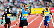 USA's Wallace Spearmon crosses first the finish line in the men's 200m final during the Diamond League athletics meeting at Crystal Palace in London on August 14, 2010.