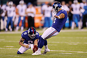 New York Giants punter Brad Wing (9) holds while New York Giants kicker Aldrick Rosas (2) kicks a second quarter extra point that ties the score at 7-7 during the 2017 NFL week 2 regular season football game against the against the Detroit Lions, Monday, Sept. 18, 2017 in East Rutherford, N.J. The Lions won the game 24-10. (©Paul Anthony Spinelli)