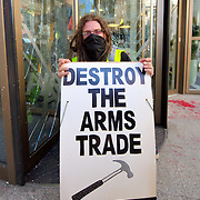 LONDON, ENGLAND - SEPTEMBER 08:  A protester in front of the Axa building in the City of London where the door was smashed. Several building were tageted today part of protests held agains the arm trade, on September 8, 2009 in London, England.  (Photo by Marco Secchi/Getty Images)