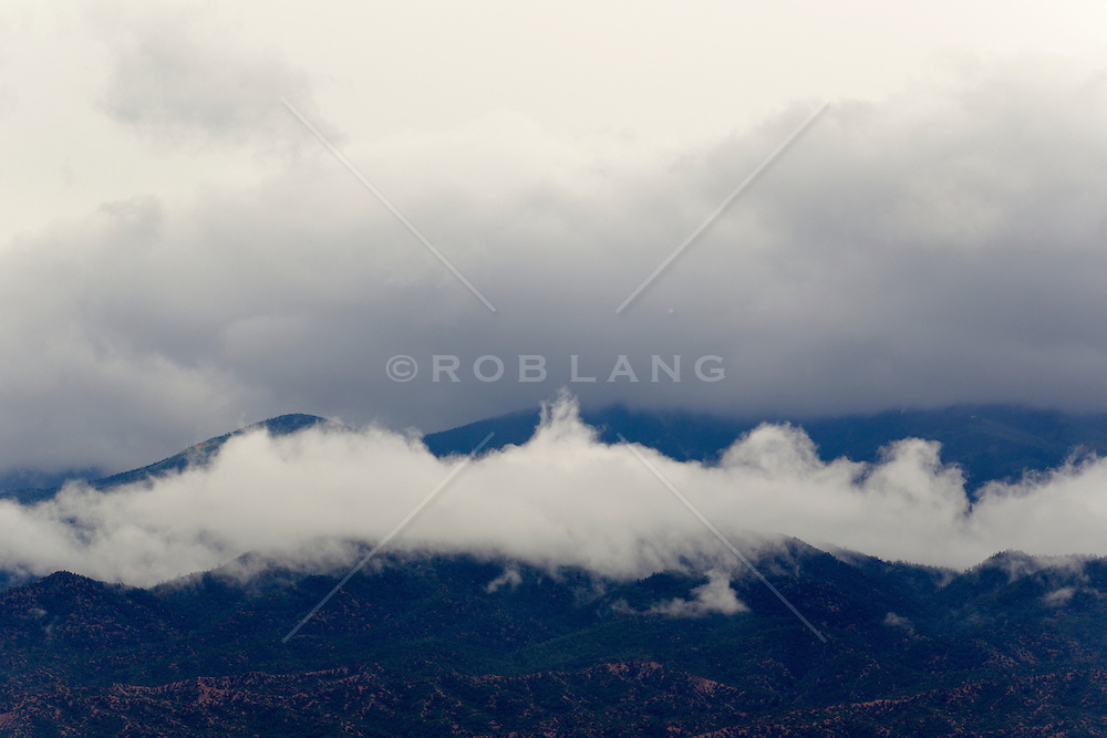 low clouds over the Santa Fe Mountains of New Mexico