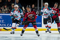 KELOWNA, BC - JANUARY 26: Justin Sourdif #42 of the Vancouver Giants looks for the pass ahead of Nolan Foote #29 and Kaedan Korczak #6 of the Kelowna Rockets  at Prospera Place on January 26, 2019 in Kelowna, Canada. (Photo by Marissa Baecker/Getty Images)