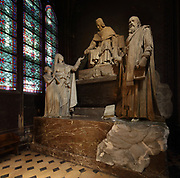 Monument to Monseigneur de Belloy, archbishop, 1709-1808, 1818, by Louis-Pierre Deseine, in the Chapelle Saint-Marcel, the 7th chapel of the ambulatory, in the Cathedrale Notre-Dame de Paris, or Notre-Dame cathedral, built 1163-1345 in French Gothic style, on the Ile de la Cite in the 4th arrondissement of Paris, France. Belloy was the 13th archbishop of Paris and his tomb was commissioned by Napoleon. Photographed on 17th December 2018 by Manuel Cohen