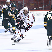 Tanner Pond #22 of the Northeastern Huskies skates with the puck during the game at Matthews Arena on January 18, 2014 in Boston, Massachusetts. (Photo by Elan Kawesch)