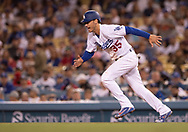 June 12, 2018 - Los Angeles, CA, U.S. - LOS ANGELES, CA - JUNE 12: Los Angeles Dodgers first baseman Cody Bellinger (35) takes off running for second base during the game between the Texas Rangers and the Los Angeles Dodgers on June 12, 2018, at Dodger Stadium in Los Angeles, CA. (Photo by David Dennis/Icon Sportswire) (Credit Image: © David Dennis/Icon SMI via ZUMA Press)