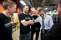 President Barack Obama tours MAGNET (Manufacturing Advocacy and Growth Network) at Cleveland State University in Cleveland, Ohio, March 18, 2015. Tom Lix, the CEO and founder of Cleveland Whiskey gives an overview of the company during a workshop with employees Ethan Snyder, left, and Jim Waltz. (Official White House Photo by Pete Souza)<br /> <br /> This official White House photograph is being made available only for publication by news organizations and/or for personal use printing by the subject(s) of the photograph. The photograph may not be manipulated in any way and may not be used in commercial or political materials, advertisements, emails, products, promotions that in any way suggests approval or endorsement of the President, the First Family, or the White House.