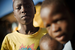 Young boy and friends.<br /> Kibera slum, Nairobi, Kenya.