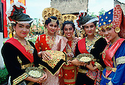 Indonesian girls in traditional dress bearing treats, Java RESERVED USE - NOT FOR DOWNLOAD -  FOR USE CONTACT TIM GRAHAM
