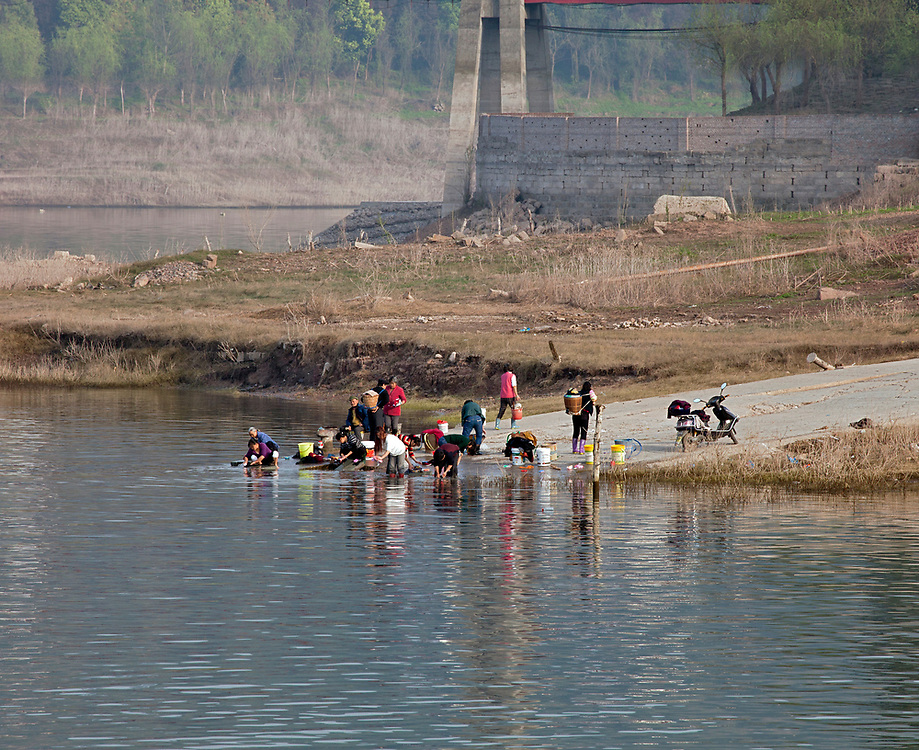Local families do their clothes washing in the Yangtze River near the cruise ship dock.