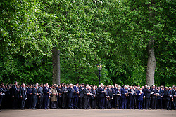 © London News Pictures. 14/05/2017. London, UK. Serving and former Cavalrymen gather around the bandstand for a service. Thousands of serving and former Cavalrymen, many wearing bowler hats and carrying closed umbrellas, take part in Combined Cavalry Old Comrades Association Annual Parade in Hyde Park, London. A service of remembrance is held to honour Cavalry and other troops who have fallen in the service of their country since the first world war. Photo credit: Ben Cawthra/LNP