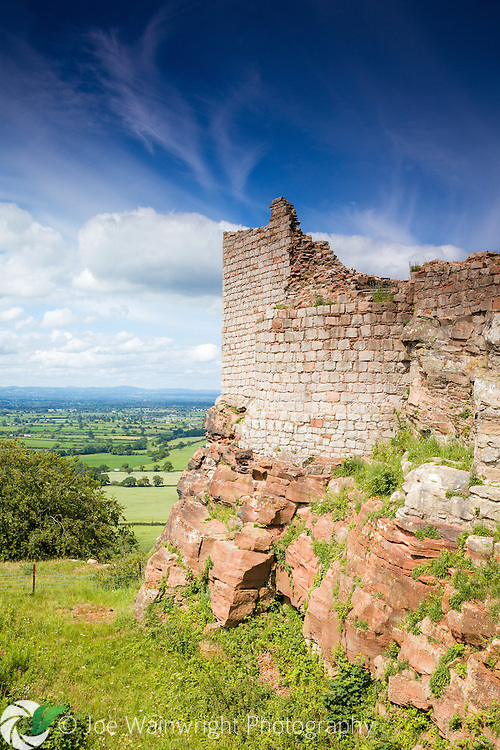 The walls of the Inner Ward of the 13th century Beeston Castle, overlook the verdant Cheshire Plain.