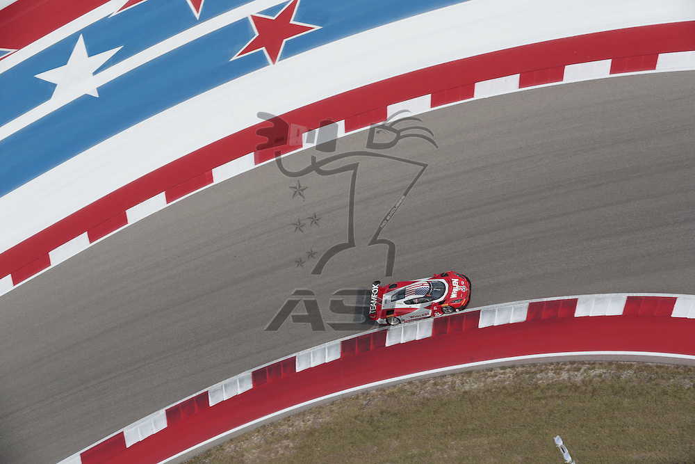 Austin, TX - Sep 15, 2016:  The Action Express Racing Corvette DP races through the turns at the Lone Star Le Mans at Circuit of the Americas in Austin, TX.