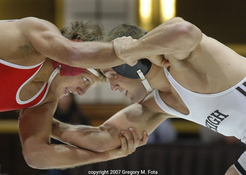 WRESTLING_Lock--Wrestlers lock arms and eyes at.Lehigh vs  Rutgers wrestling match, Grace Hall,Lehigh Univ., Bethlehem,PA- 149 lb class-Trevor Chinn /Lehigh. (Photo:Gregory M. Fota)11302007