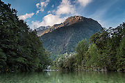 Sunset drapes over Mount Te Anau (1956m), as viewed from the middle of the Clinton River in Fiordland.