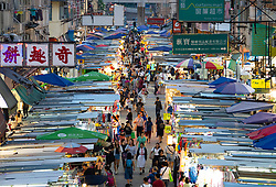Night view of traditional street market on Fa Yuen Street in Mongkok , Kowloon, Hong Kong.