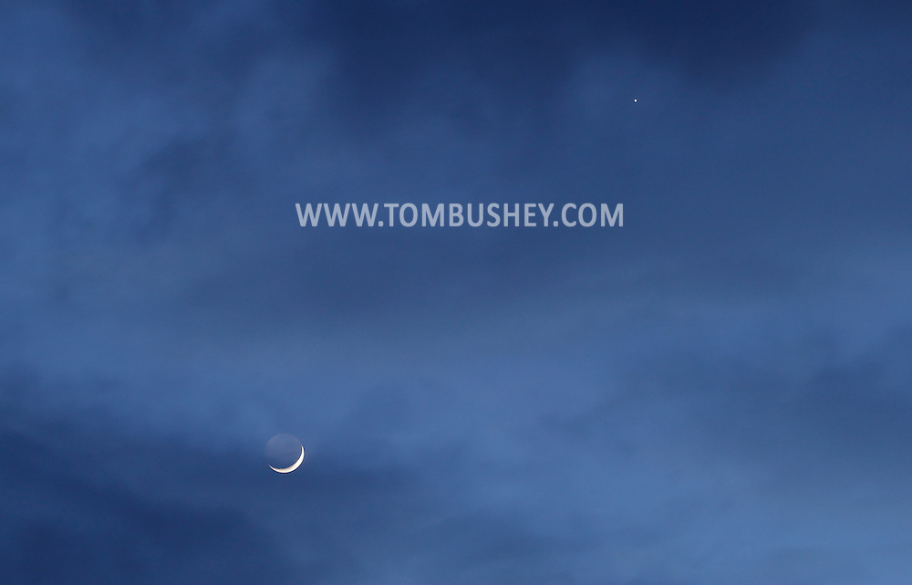 Middletown, New York - The cresent moon and the planet Venus, upper right, shine in the night sky on April 24, 2012.