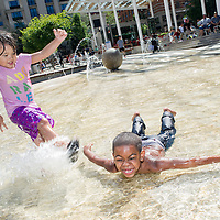 Chloe Phan (left) plays tag with Mykel Love-Loman in the pool at Director Park in Portland. 3:54pm