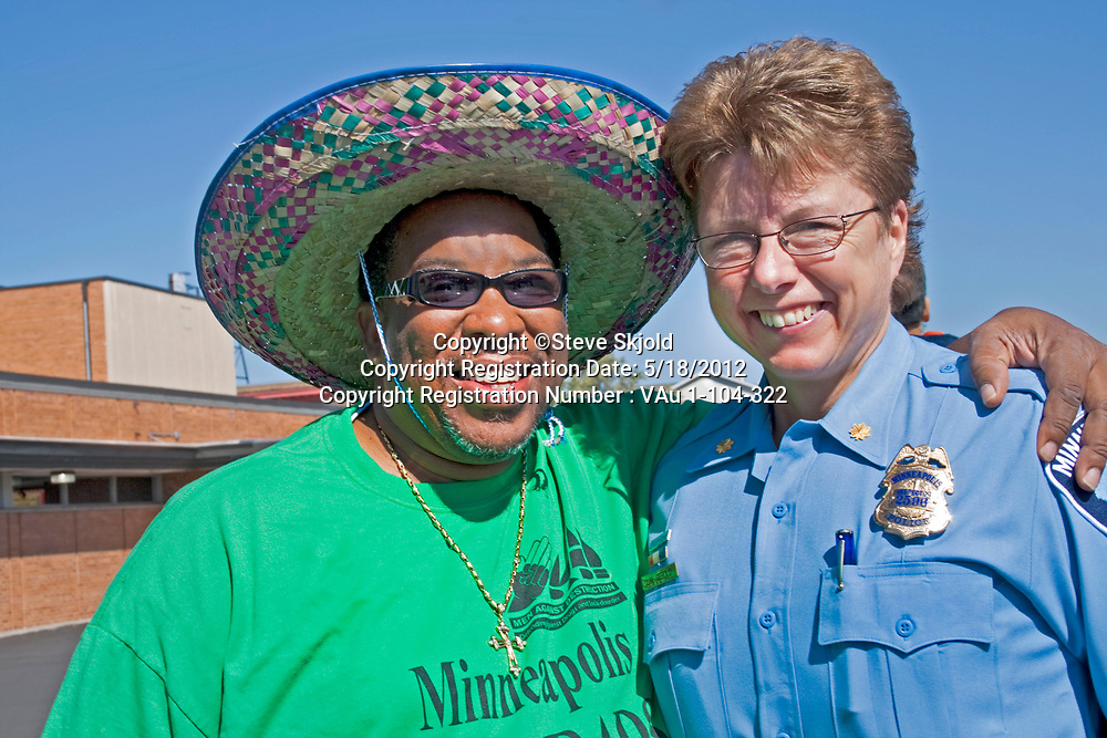 Female police inspector relating to one of the celebration leaders. Mexican Independence Day Minneapolis Minnesota MN USA