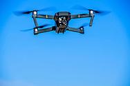a drone is flying in the sky een man vliegt met een drone in de lucht , filmen opnames , foto's maken uit de lucht copyrught robin utrecht