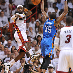 Jun 17, 2012; Miam, FL, USA; Miami Heat small forward LeBron James (6) passes against Oklahoma City Thunder small forward Kevin Durant (35) during the first quarter in game three in the 2012 NBA Finals at the American Airlines Arena. Mandatory Credit: Derick E. Hingle-US PRESSWIRE