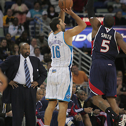 05 November 2008:  New Orleans Hornets forward Peja Stojakovic (16) shoots as Atlanta Hawks forward Josh Smith (5) comes in for the block during the first half of a NBA game between the New Orleans Hornets and the Atlanta Hawks at the New Orleans Arena in New Orleans, LA..