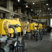 February 19, 2015 - New York, NY : Centrifuges fill a room at the Newtown Creek Wastewater Treatment Plant. The plant, located in Greenpoint, Brooklyn, is the largest of New York City's 14 wastewater treatment plants. The centrifuges are used to separate the sewage sludge from the wastewater, thickening the solids so that they can be broken down further. CREDIT: Karsten Moran for The New York Times